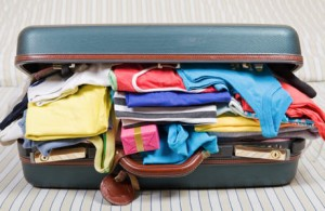 Open-Suitcase-with-Clothing460x300